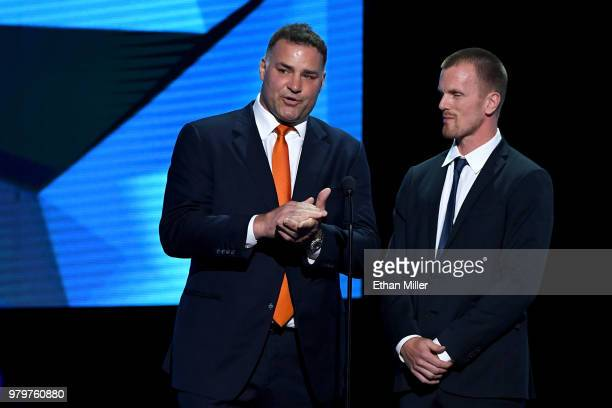 Hockey Hall of Fame member Eric Lindros and Daniel Sedin of the Vancouver Canucks present an award onstage at the 2018 NHL Awards presented by Hulu...