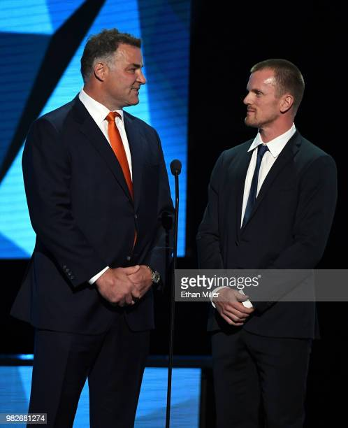 Hockey Hall of Fame member Eric Lindros and Daniel Sedin of the Vancouver Canucks present an award during the 2018 NHL Awards presented by Hulu at...