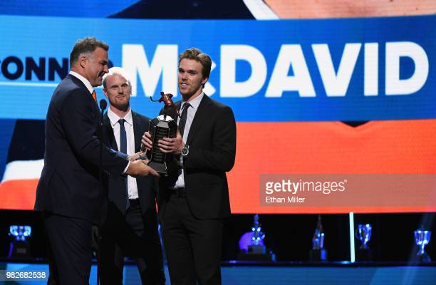 Hockey Hall of Fame member Eric Lindros and Daniel Sedin of the Vancouver Canucks present Connor McDavid of the Edmonton Oilers with the Ted Lindsay...