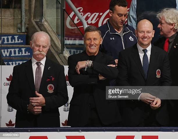 Hockey Hall of Fame members Lanny McDonald Borje Salming and Mats Sundin take part in pregame ceremonies prior to the game between the Toronto Maple...