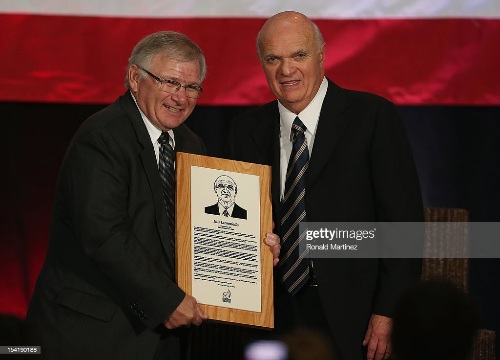 U.S. Hockey Hall of Fame President, Ron DeGregorio presents a plaque to Lou Lamoriello after his induction into the U.S. Hockey Hall of Fame during the 40th annual U.S. Hockey Hall of Fame Induction Ceremony & Dinner at Plaza of the Americas on October 15, 2012 in Dallas, Texas.