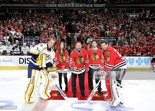 Hockey Hall of Famer Eddie Belfour drops the 'Ceremonial Puck' with goalie Pekka Rinne of the Nashville Predators and goalie Corey Crawford of the...