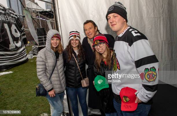 Hockey Hall of Famer Tony Esposito poses for a photo with fans during the Bridgestone NHL Winter Classic Park fan festival at Millenium Park on...
