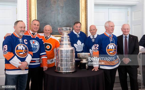 Hockey Hall of Famers Bryan Trottier Paul Coffey Bernie Parent Frank Mahovlich Dave Keon and Mike Bossy pose with David Johnston Governor General of...