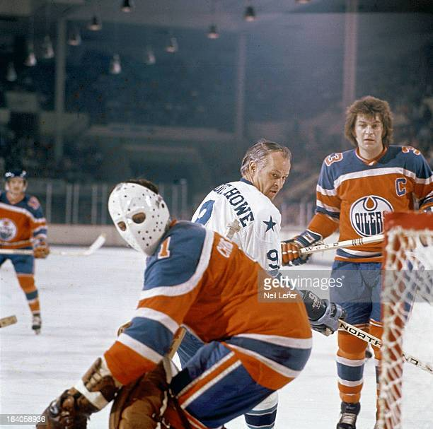 Houston Aeros Gordie Howe in action vs Edmonton Oilers goalie Chris Worthy and Al Hamilton at Sam Houston Coliseum Houston TX CREDIT Neil Leifer