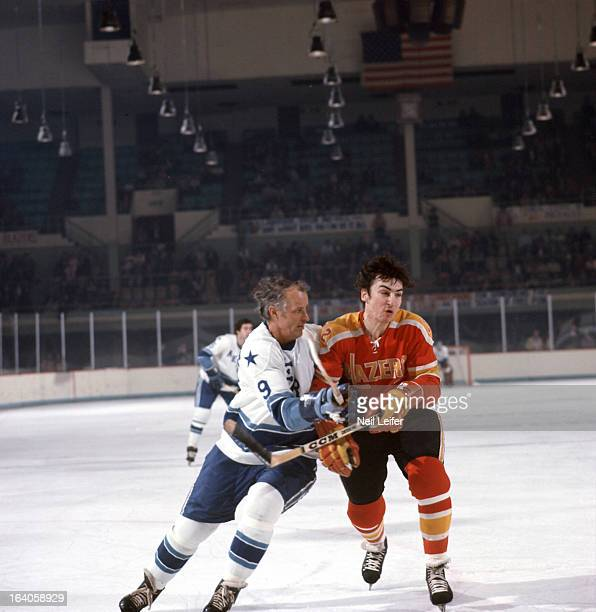 Houston Aeros Gordie Howe in action vs Vancouver Blazers Don O'Donoghue at Sam Houston Coliseum Houston TX CREDIT Neil Leifer