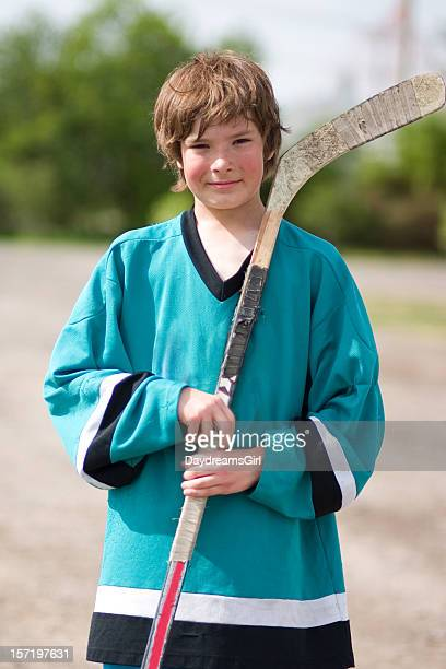 hockey kid - hockey stick stock pictures, royalty-free photos & images