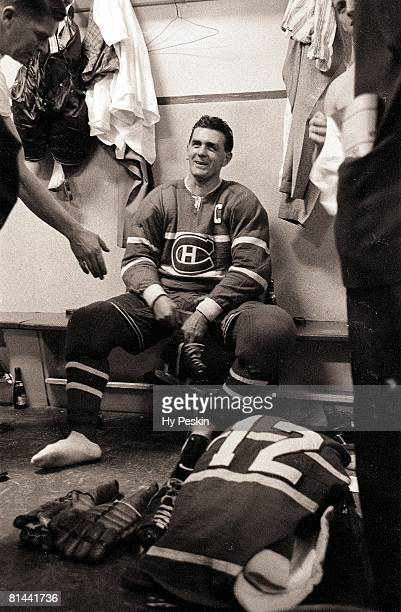Hockey Maurice 'Rocket' Richard of the Montreal Canadiens sits in the locker room after scoring his 500th career goal during game against the Chicago...