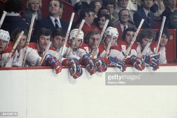 Montreal Canadiens coach Scotty Bowman on bench with Guy Lafleur and team during game vs New York Rangers Montreal Canada 2/20/1976 CREDIT Manny...
