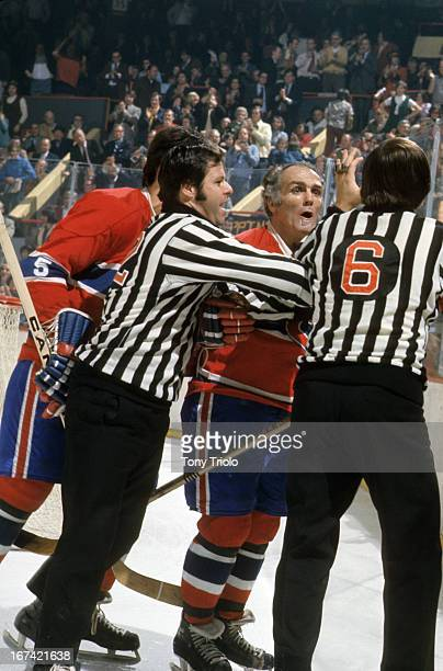 Montreal Canadiens Henri Richard upset with referee during game vs Boston Bruins at Boston Garden Boston MA CREDIT Tony Triolo