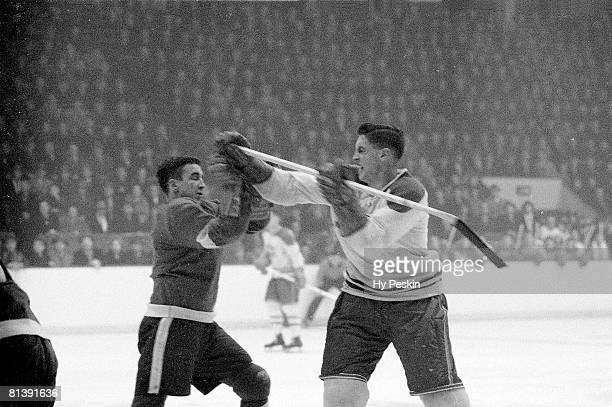 Hockey Montreal Canadiens Jean Beliveau in action vs Detroit Red Wings Ted Lindsay during fight Montreal CAN 2/17/1955