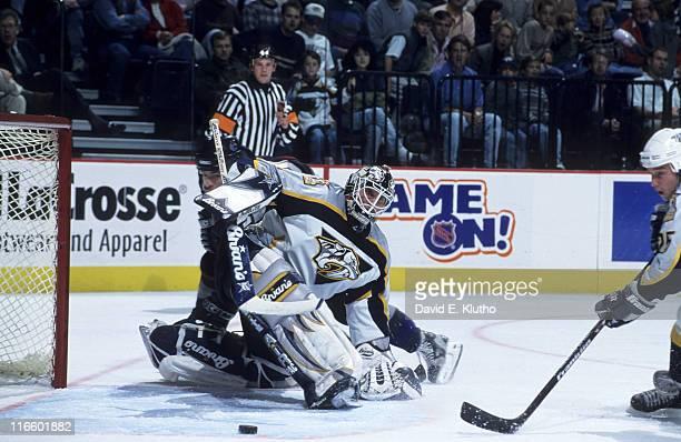 Nashville Predators goalie Mike Dunham in action, making save vs Vancouver Canucks Brad May at Nashville Arena. Nashville, TN CREDIT: David E. Klutho
