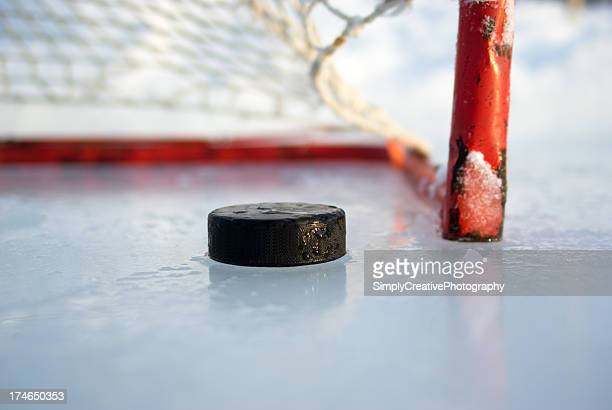 hockey net and puck - hockey puck stock pictures, royalty-free photos & images