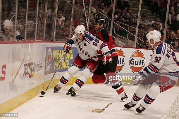 Hockey New York Rangers Jaromir Jagr in action vs New Jersey Devils Sean Brown East Rutherford NJ 11/3/2005