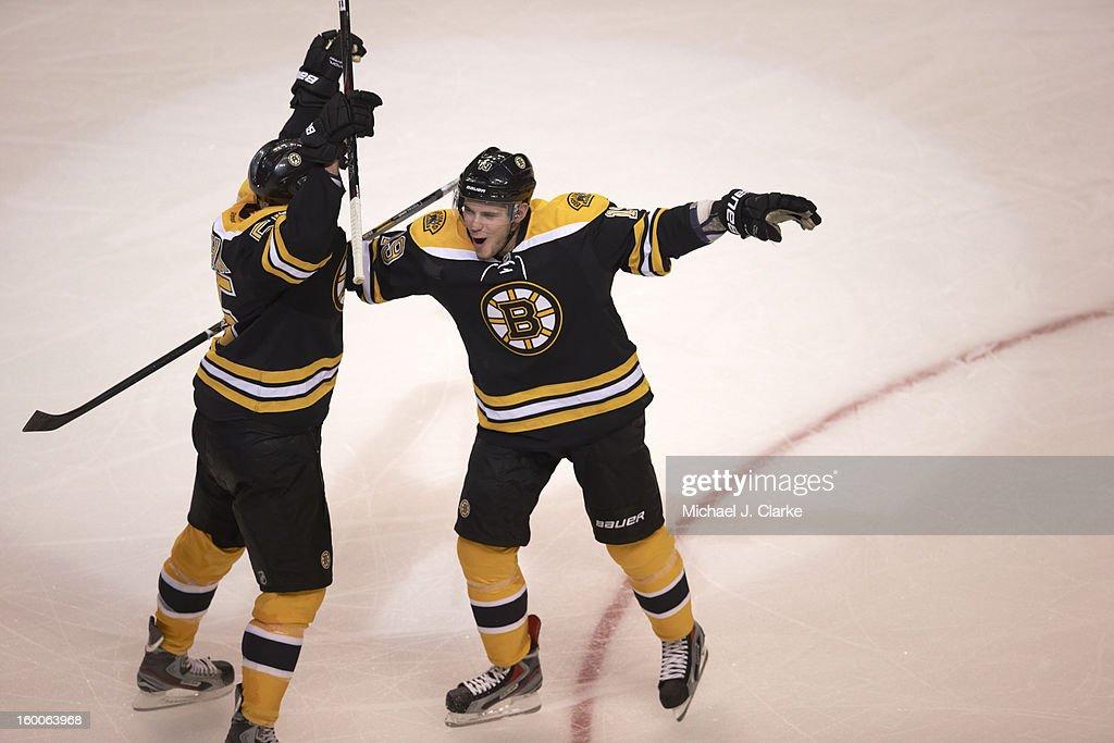 New York Rangers Johnny Boychuk (55) victorious after scoring goal with Tyler Seguin (19) vs Boston Bruins at TD Garden. Michael J. Clarke F35 )