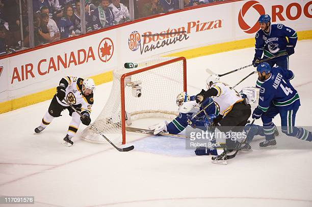 NHL Finals Boston Bruins Brad Marchand in action goal and Patrice Bergeron vs Vancouver Canucks goalie Roberto Luongo and Andrew Alberts at Rogers...