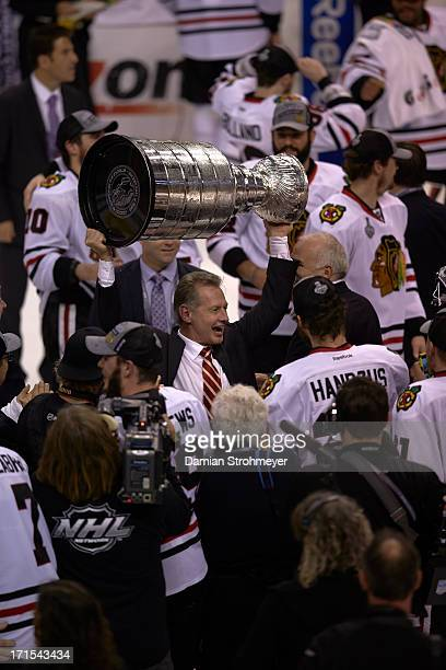 Chicago Blackhawks assistant coach Mike Kitchen victorious with Stanley Cup Trophy after winning Game 6 and championship vs Boston Bruins at TD...