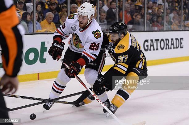 NHL Finals Chicago Blackhawks Bryan Bickell in action vs Boston Bruins Patrice Bergeron at TD Garden Game 4 Boston MA CREDIT David E Klutho
