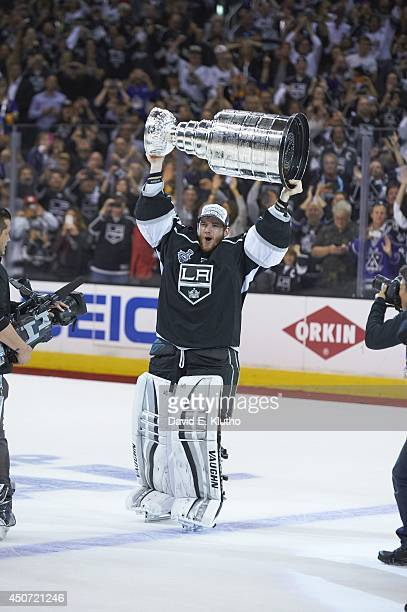 Los Angeles Kings goalie Jonathan Quick victorious, holding up Stanley Cup after winning game and series vs New York Rangers at Staples Center. Game...
