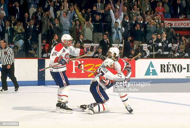 NHL Finals Montreal Canadiens Eric Desjardins and Mathieu Schneider victorious after goal vs Los Angeles Kings Game 2 Montreal Canada 6/3/1993 CREDIT...