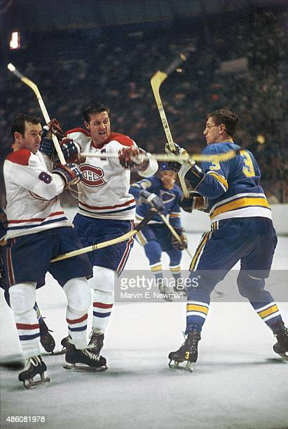 NHL Finals Montreal Canadiens Jean Beliveau and Dick Duff in action scrum vs St Louis Blues Al Arbour during Game 1 at St Louis Arena Game 1 St Louis...