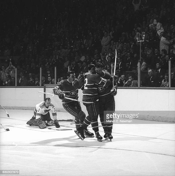 NHL Finals Montreal Canadiens John Ferguson Yvan Cournoyer and Ted Harris victorious after goal vs St Louis Blues at Montreal Forum Game 3 Montreal...