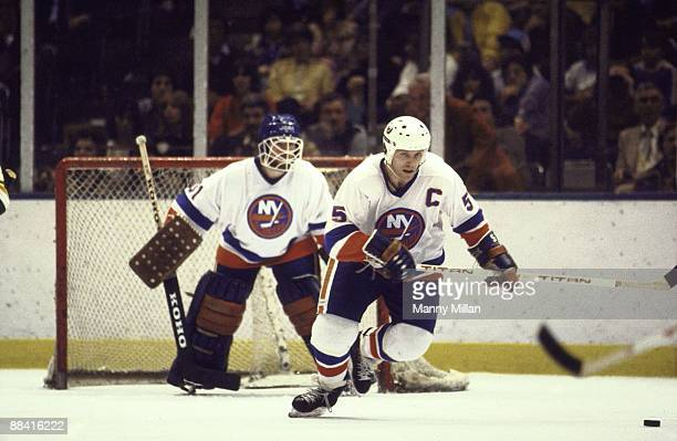 NHL Finals New York Islanders Denis Potvin in action vs Minnesota North Stars View of Islanders goalie Billy Smith in background Game 1 Uniondale NY...