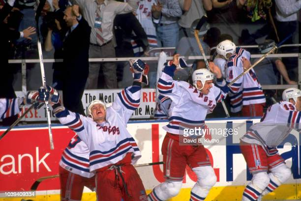 NHL Finals New York Rangers Adam Graves and Jeff Beukeboom victorious on ice after winning game and series vs Vancouver Canucks at Madison Square...