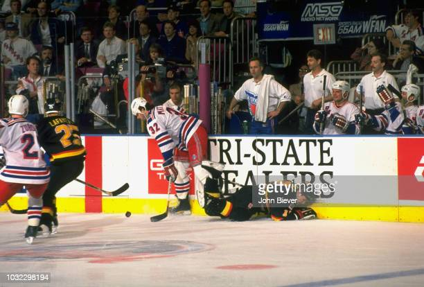 NHL Finals New York Rangers Stephane Matteau in action vs Vancouver Canucks Shawn Antoski at Madison Square Garden Game 1 New York NY CREDIT John...