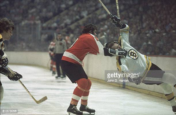 Hockey NHL Finals Philadelphia Flyers Dave Schultz in action cross check vs Boston Bruins Wayne Cashman Game 5 Boston MA 5/16/1974