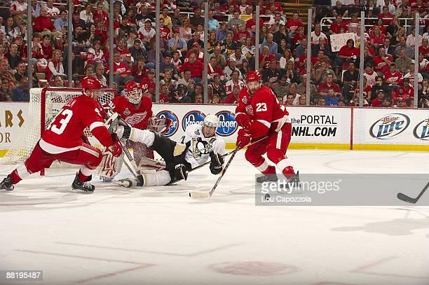 NHL Finals Pittsburgh Penguins Evgeni Malkin in action vs Detroit Red Wings goalie Chris Osgood and Brad Stuart Game 1 Detroit MI 5/30/2009 CREDIT...