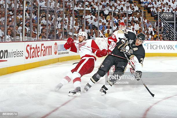 NHL Finals Pittsburgh Penguins Evgeni Malkin in action collision with Detroit Red Wings Niklas Kronwall Game 4 Pittsburgh PA 6/4/2009 CREDIT Lou...