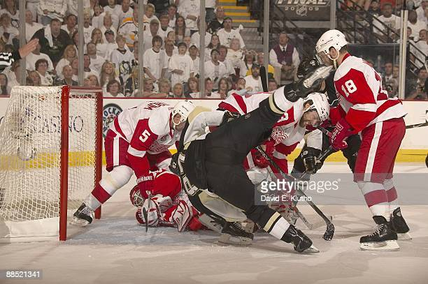 NHL Finals Pittsburgh Penguins Sidney Crosby in action vs Detroit Red Wings Brad Stuart and goalie Chris Osgood Game 3 Pittsburgh PA 6/2/2009 CREDIT...