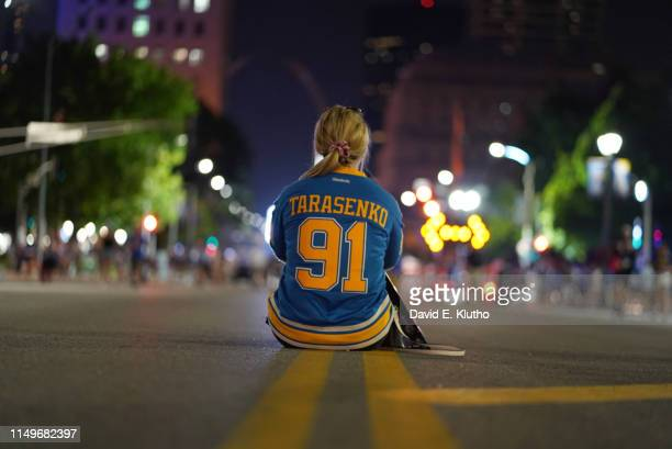 St. Louis Blues fan seated in street wearing Tarasenko jersey outside of arena during Game 6 vs Boston Bruins at Enterprise Center. St. Louis, MO...