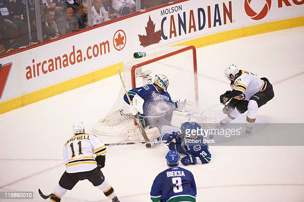 NHL Finals Vancouver Canucks goalie Roberto Luongo in action vs Boston Bruins Patrice Bergeron at Rogers Arena Game 1 Vancouver Canada 6/1/2011...