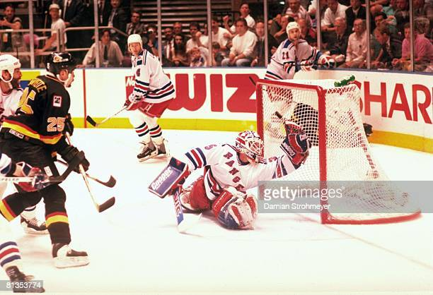 Hockey NHL Finals Vancouver Canucks Nathan Lafayette in action taking shot and hitting post vs New York Rangers goalie Mike Richter New York NY...