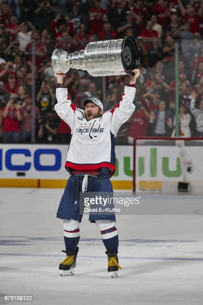 NHL Finals Washington Capitals Alex Ovechkin victorious holding Stanley Cup trophy over his head after winning Game 5 and championship series vs...