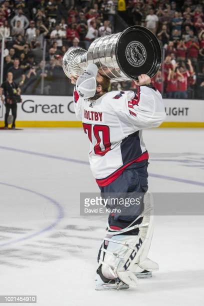 NHL Finals Washington Capitals Devante SmithPelly victorious holding Stanley Cup trophy over his head after winning Game 5 and championship series vs...