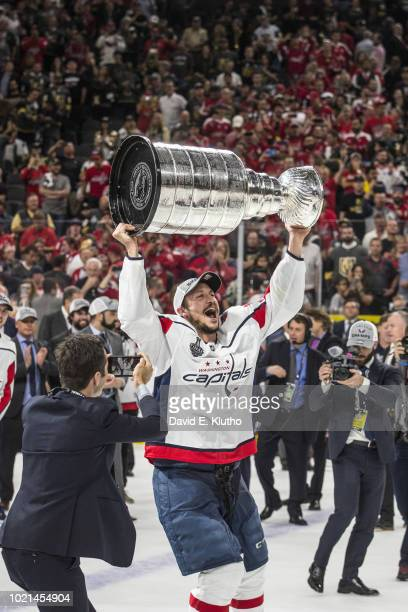 NHL Finals Washington Capitals Jay Beagle victorious holding Stanley Cup trophy over his head after winning Game 5 and championship series vs Vegas...