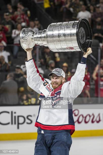NHL Finals Washington Capitals Lars Eller victorious holding Stanley Cup trophy over his head after winning Game 5 and championship series vs Vegas...