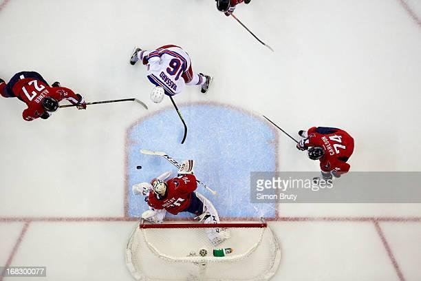 NHL Playoffs Aerial view of New York Rangers Derick Brassard in action vs Washington Capitals Karl Alzner and goalie Braden Holtby at Verizon Center...
