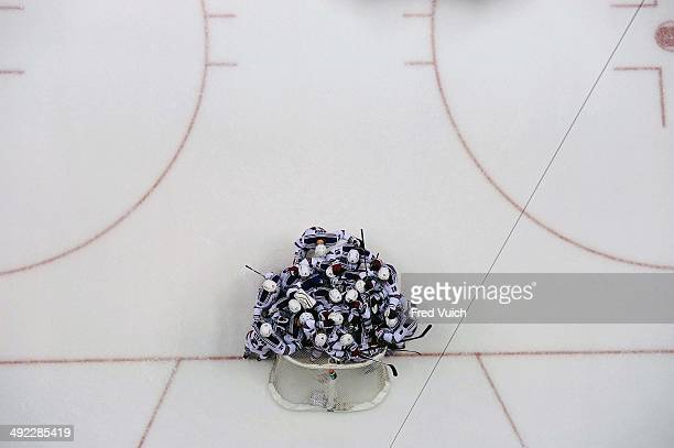 NHL Playoffs Aerial view of New York Rangers goalie Henrik Lundqvist victorious with teammates after winning game vs Pittsburgh Penguins at Consol...