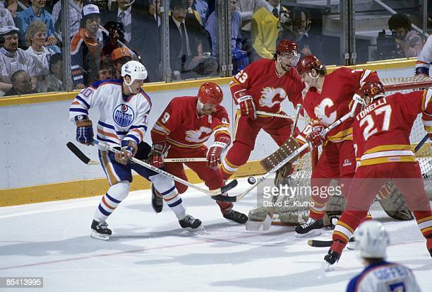 NHL Playoffs Calgary Flames Lanny McDonald in action vs Edmonton Oilers Esa Tikkanen Game 6 Calgary Canada 4/28/1986 CREDIT David E Klutho