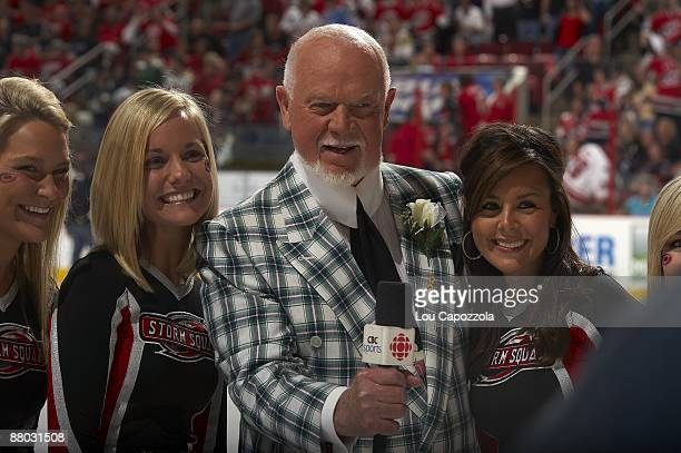 NHL Playoffs CBC Sports media announcer Don Cherry with Carolina Hurricanes Storm Squad during Game 3 vs Pittsburgh Penguins Raleigh NC 5/23/2009...