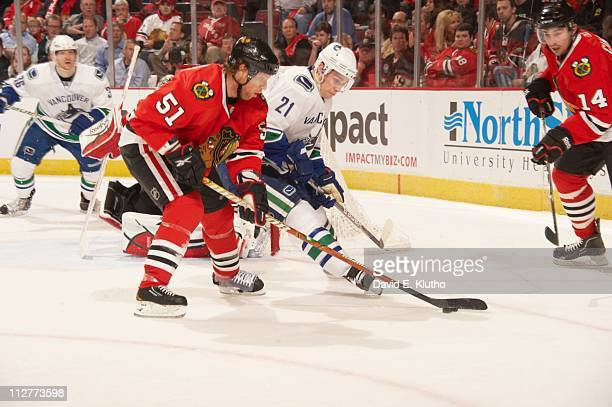 NHL Playoffs Chicago Blackhawks Brian Campbell in action vs Vancouver Canucks Mason Raymond at United Center Game 3 Chicago IL 4/17/2011CREDIT David...
