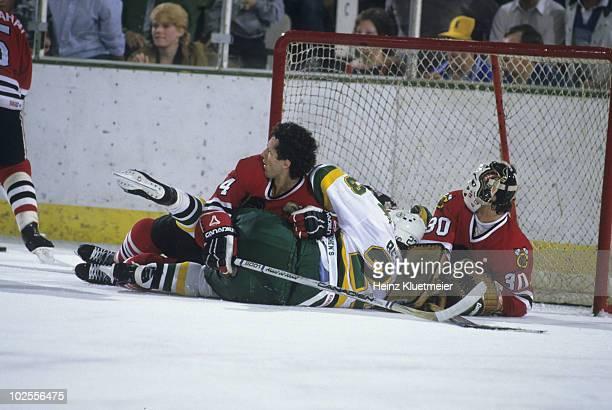 NHL Playoffs Chicago Blackhawks Doug Wilson and goalie Murray Bannerman in action vs Minnesota North Stars Brian Bellows Game 4 Bloomington MN...