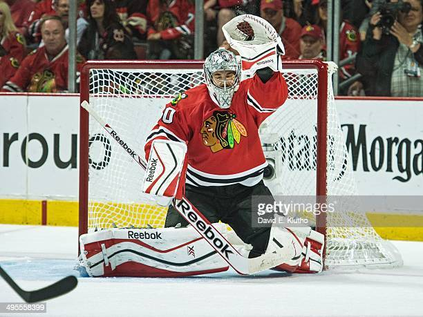 NHL Playoffs Chicago Blackhawks goalie Corey Crawford in action making glove save with eyes closed vs Los Angeles Kings at United Center Game 7...