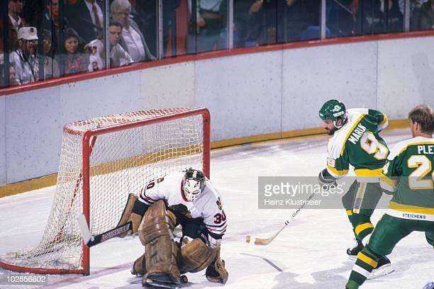 NHL Playoffs Chicago Blackhawks goalie Murray Bannerman in action making save vs Minnesota North Stars Dennis Maruk Game 5 Chicago IL 4/28/1985...