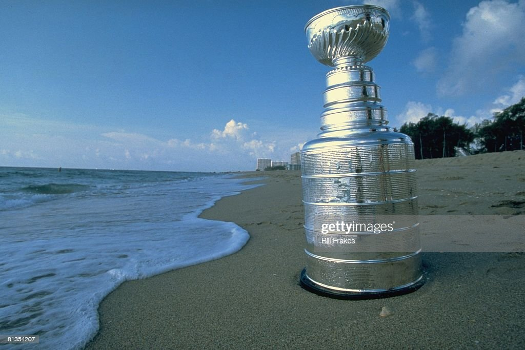 Nhl Playoffs Closeup Of Stanley Cup Trophy Standing On Sand At Beach Miami