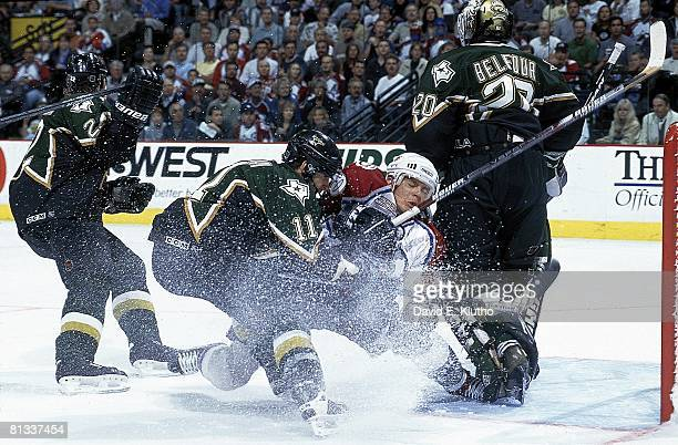 Hockey NHL Playoffs Dallas Stars Blake Sloan in action making check vs Colorado Avalanche Alex Tanguay View of Stars goalie Ed Belfour Game 6 Denver...
